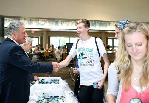 As part of a long-standing tradition, I hand out free ice cream in the Memorial Student Center. Industrial design student Josh Schaefer, center, was excited to learn that he and he and I shared the hometown of Port Washington, Wisconsin.